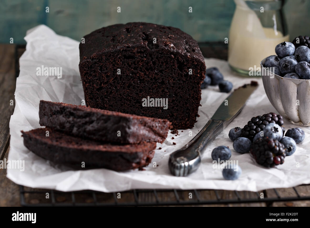 Chocolate loaf cake sliced ready to be decorated - Stock Image