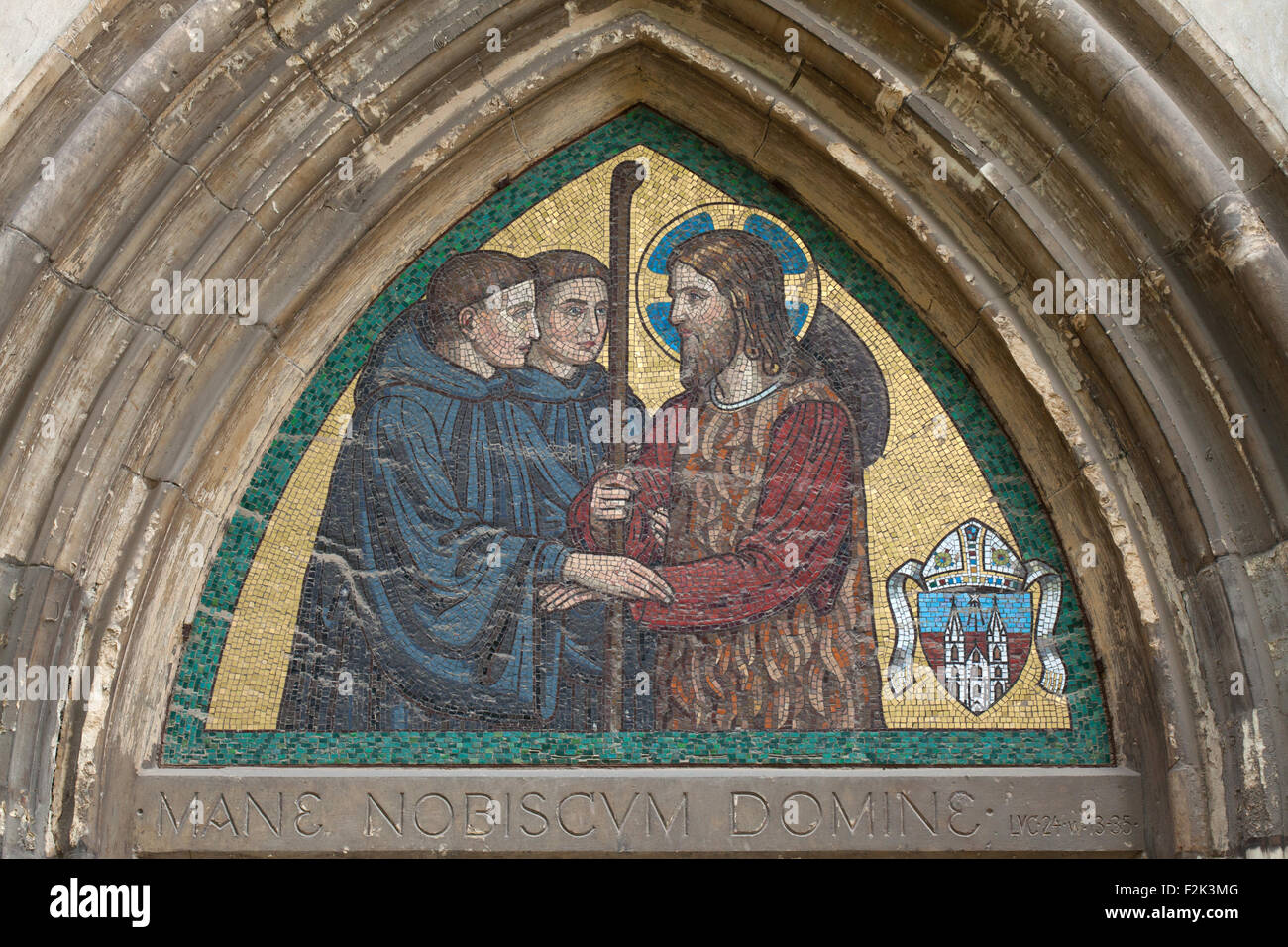 Jesus Christ blessing Benedictine monks. Mosaic by the Beuron Art School from the 1910s over the side entrance to Stock Photo