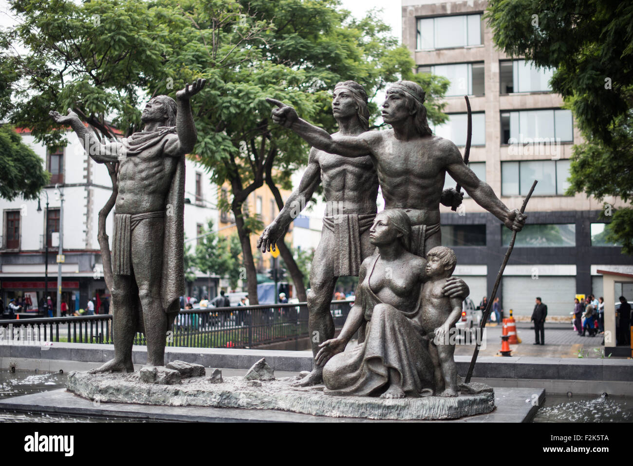 A statue of a set of pre-colonial figures in Centro Historico, Mexico City. - Stock Image
