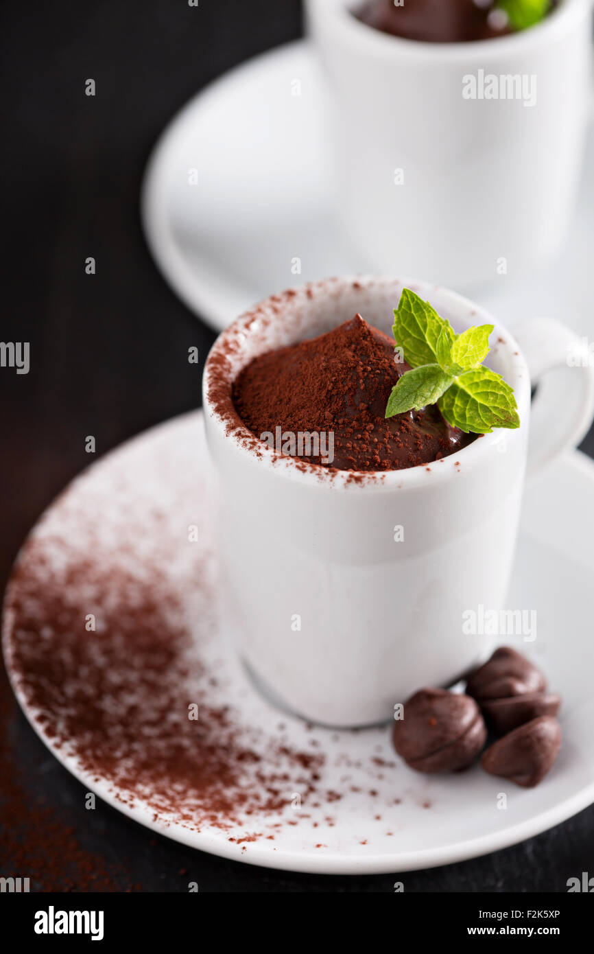 Dark chocolate pudding served in small cups - Stock Image