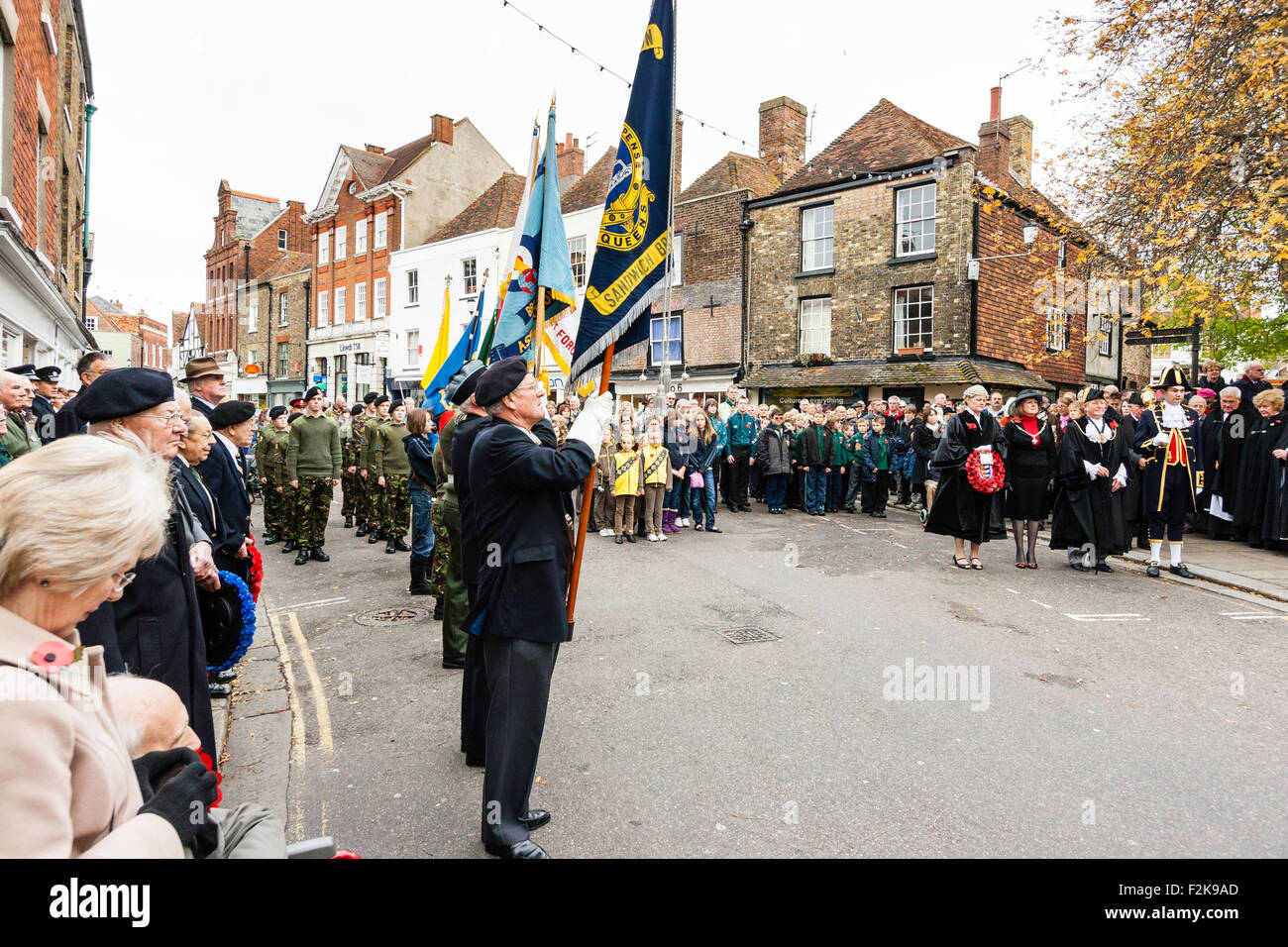 England, Sandwich. Remembrance Sunday. Ex-servicemen standing holding regimental flags during silence in town square - Stock Image