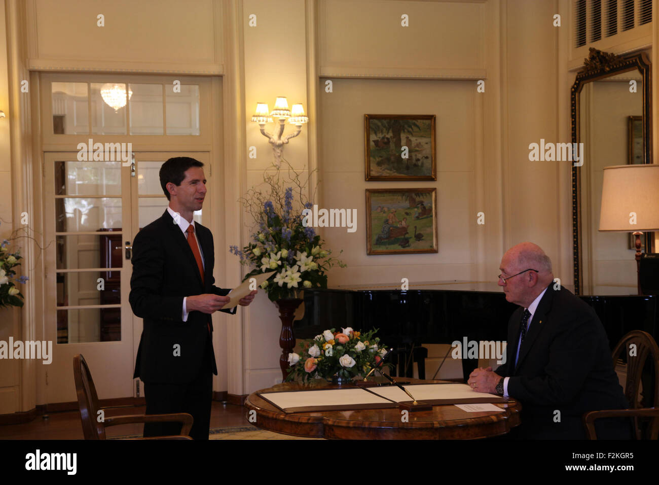 Canberra, Australia. 21st Sep, 2015. Simon Birmingham (L) is sworn in as Minister for Education and Training by - Stock Image