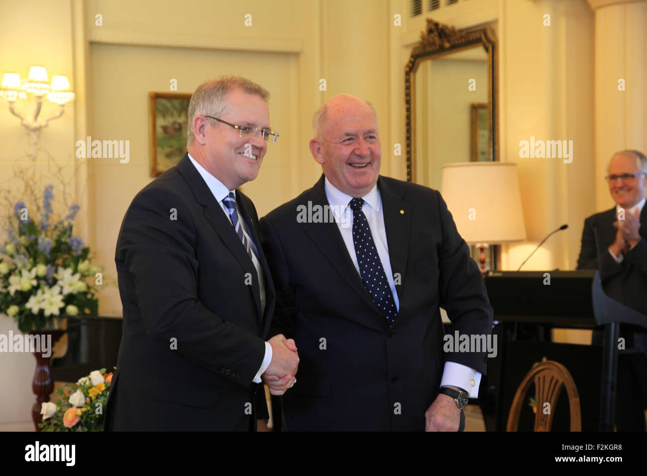 Canberra, Australia. 21st Sep, 2015. Scott Morrison (L) is sworn in as Treasurer by Governor General Sir Peter Cosgrove - Stock Image