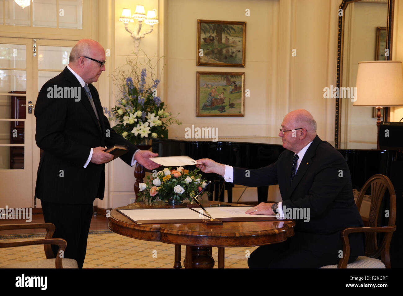 Canberra, Australia. 21st Sep, 2015. George Brandis (L) is sworn in as Attorney General by Governor General Sir - Stock Image