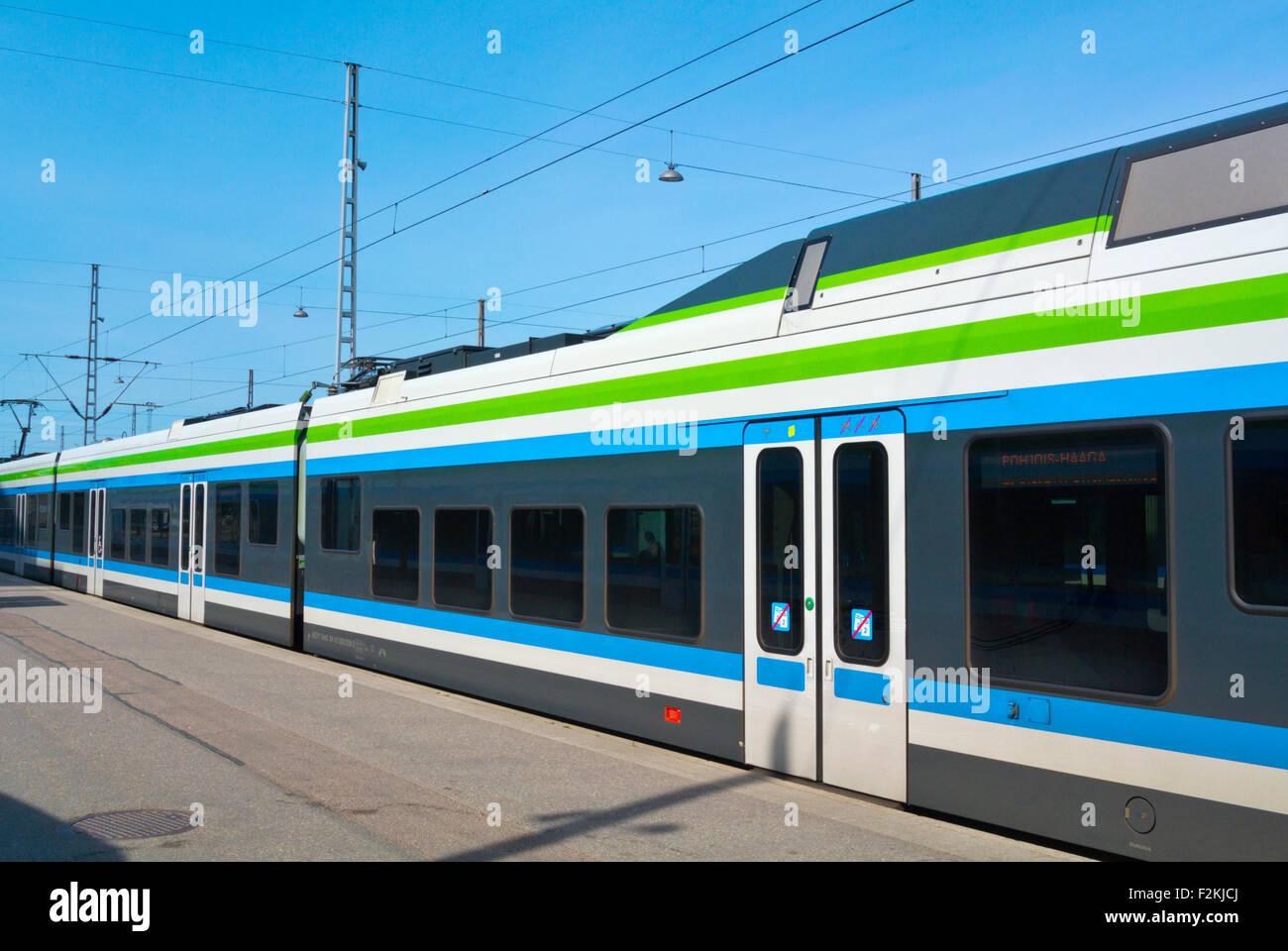 Train on station platform, Finland, Europe - Stock Image
