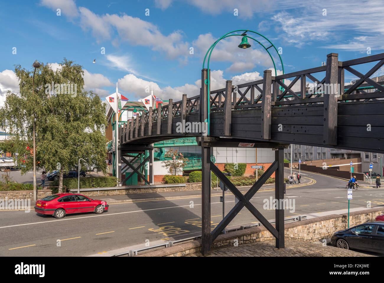 Wooden footbridge in Warrington town centre leading to the Cockhedge shopping centre. - Stock Image