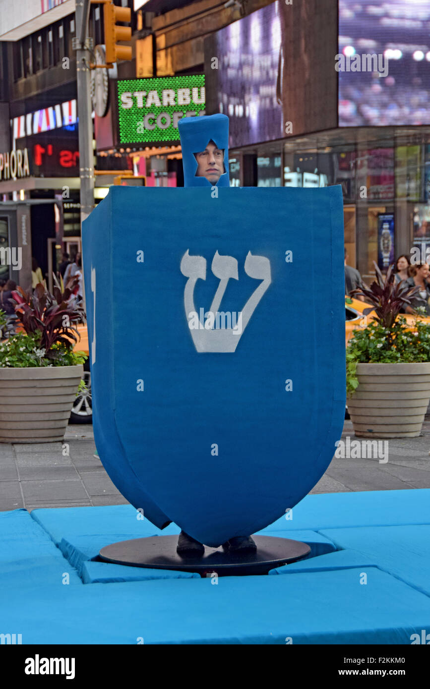 0030eff7257d5 MTV filming a holiday segment with a giant Channukah dreidel. In Times  Square