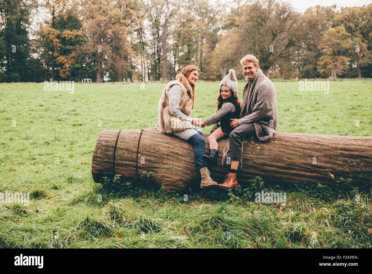 Happy family spending time together in an autumnal park - Stock Image