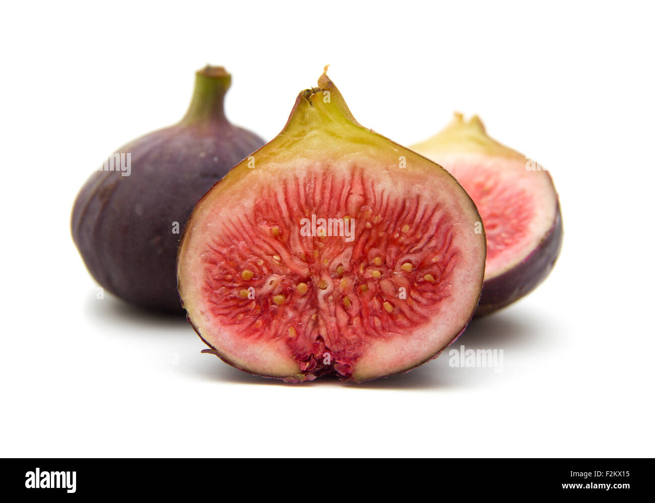 ripe purple figs isolated on white background - Stock Image