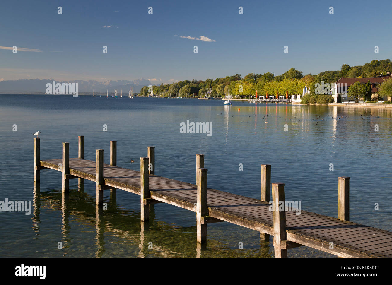 Starnberg See Lake Bavaria Germany old wooden jetties and boat moorings peaceful lake scene - Stock Image