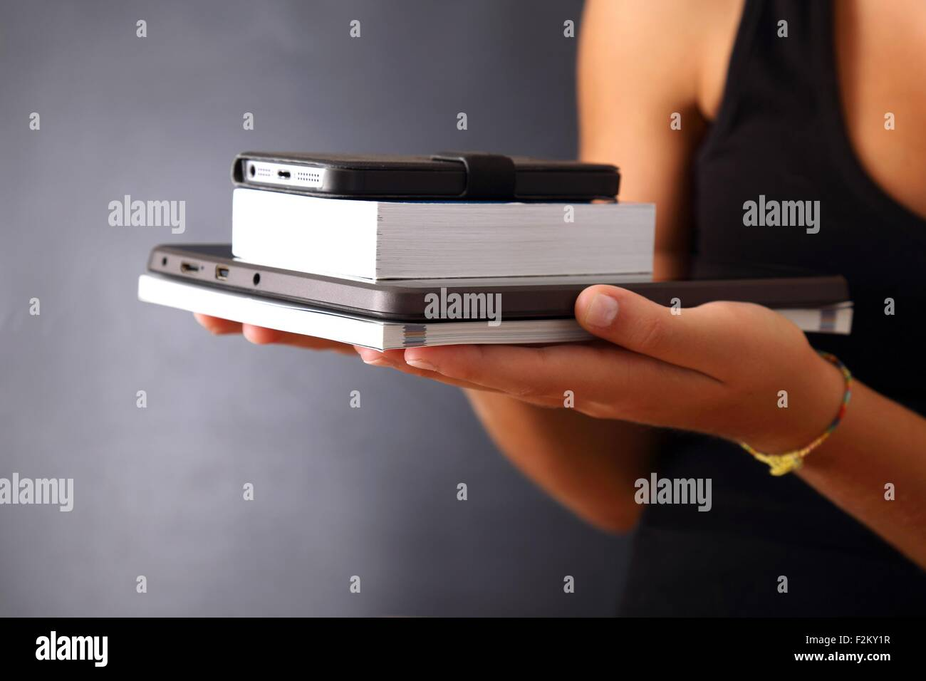 A tablet instead of books - Stock Image