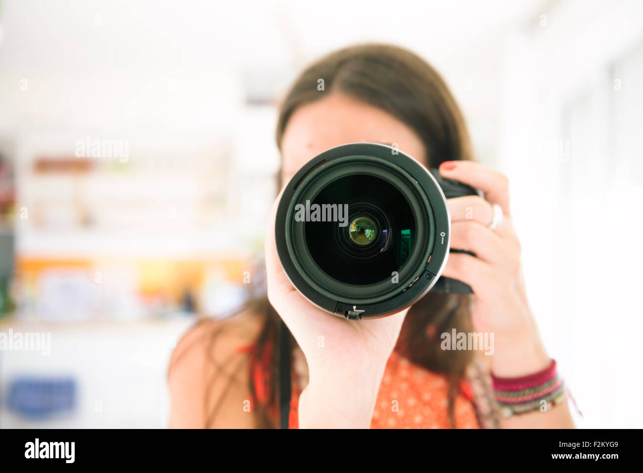 Woman taking a photo with a camera - Stock Image