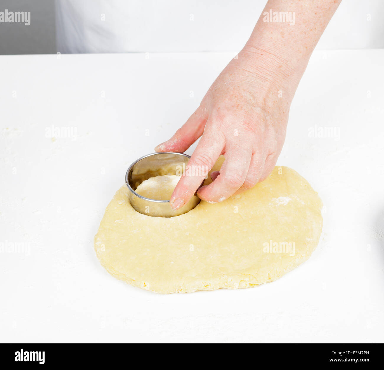 using a cookie cutter - Stock Image