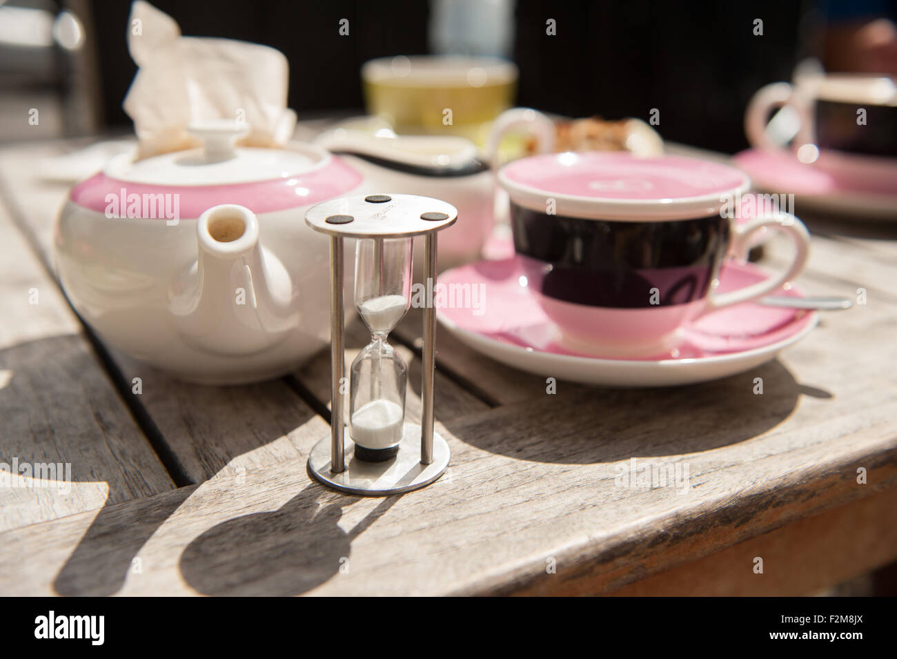 Afternoon tea with brew timer - Stock Image