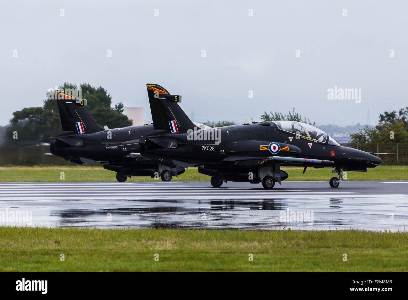 Pair of Hawk T2 preparing for take-off on the runway - Stock Image
