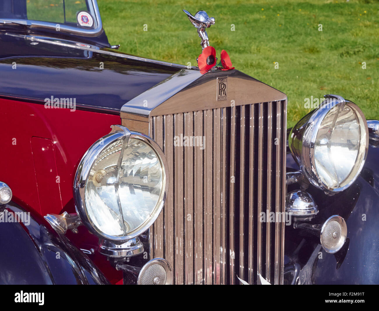 Flying Lady mascot, distinctive radiator grill and large headlamps of a 1938 Rolls Royce car. - Stock Image