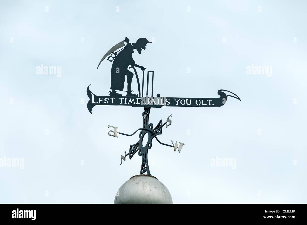 Wind vane depicting Old Father Time as a wicket keeper, on the bandstand, Racecourse sportsground, Durham City, - Stock Image