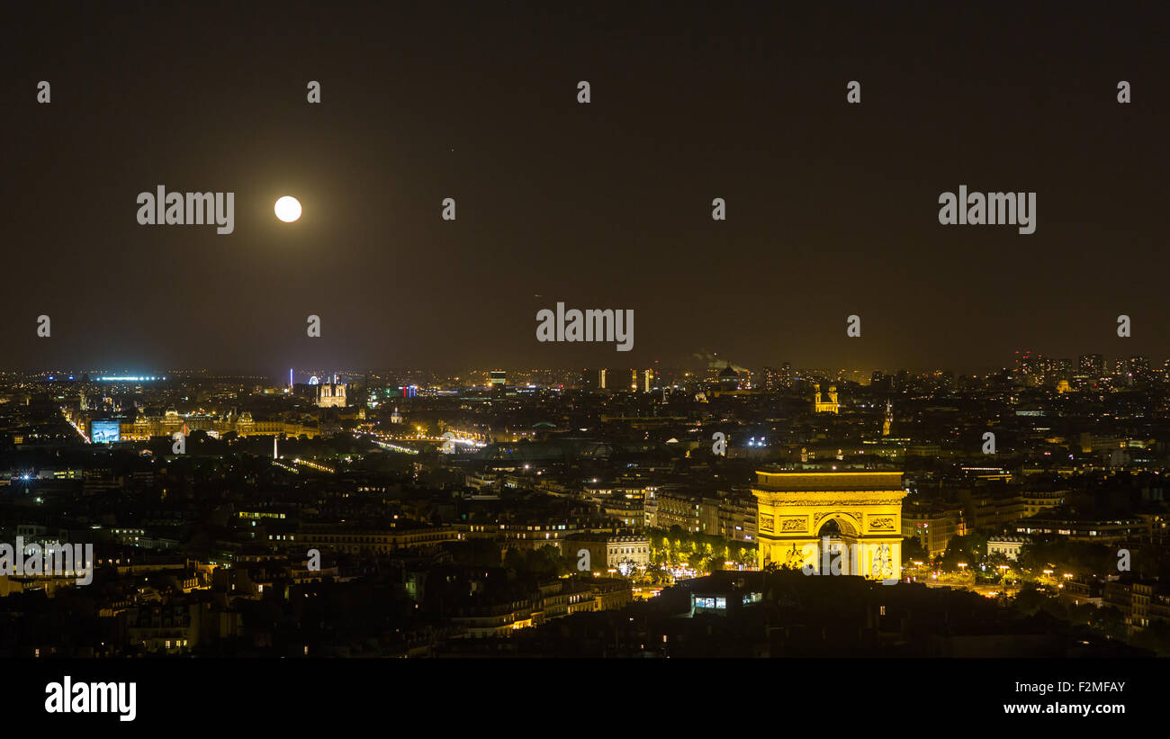 Paris, Moonrise over the Arc de Tromp and City Skyline, France - Stock Image