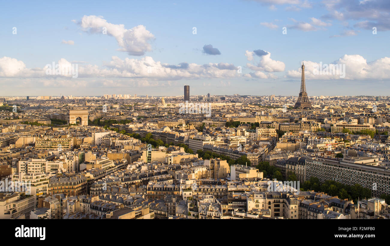 Paris City Skyline, Arc de Triomphe and the Eiffel Tower, viewed over rooftops, Paris, France, Europe - Stock Image