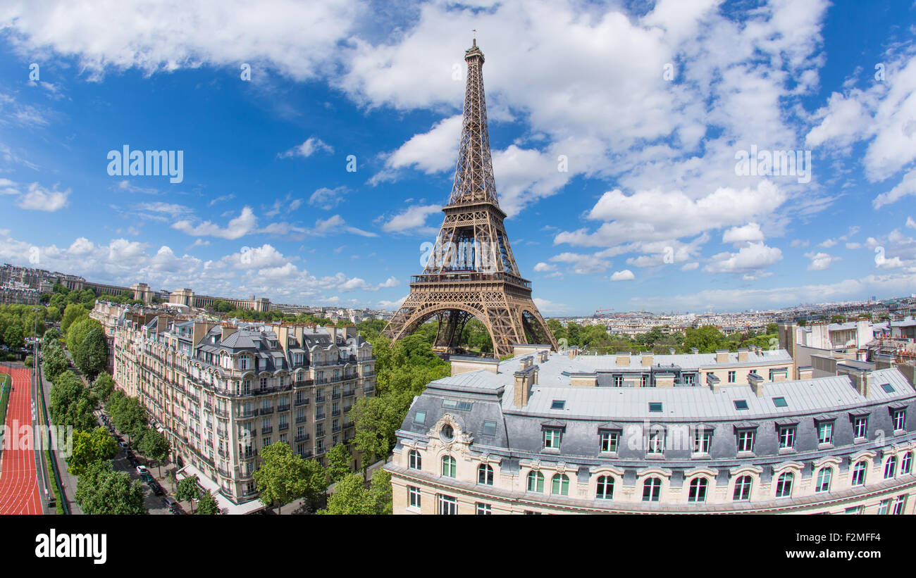 Eiffel Tower, viewed over rooftops, Paris, France, Europe - Stock Image