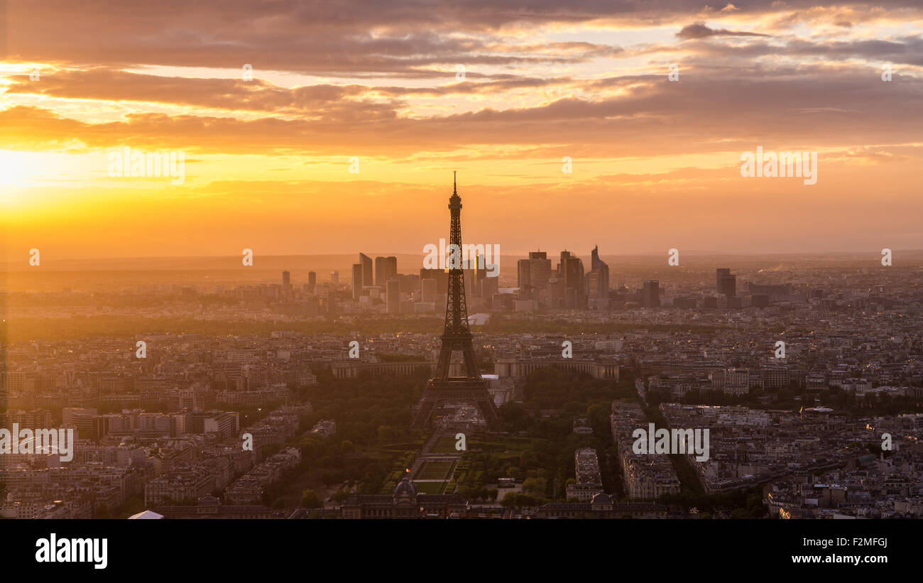 Elevated view of the Eiffel Tower, city skyline and La Defence skyscrapper district in the distance, Paris, France, Europe Stock Photo