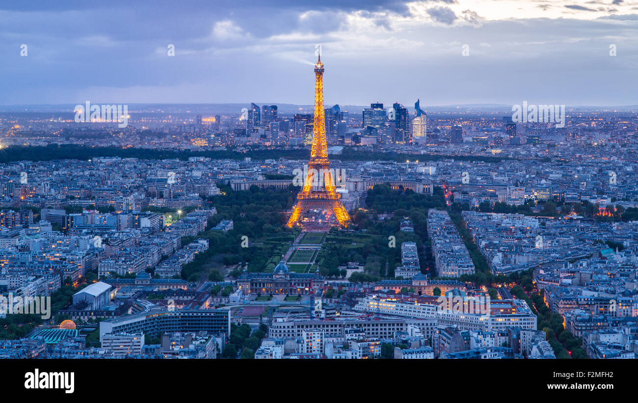 Elevated view of the Eiffel Tower, city skyline and La Defence skyscrapper district in the distance, Paris, France, Stock Photo