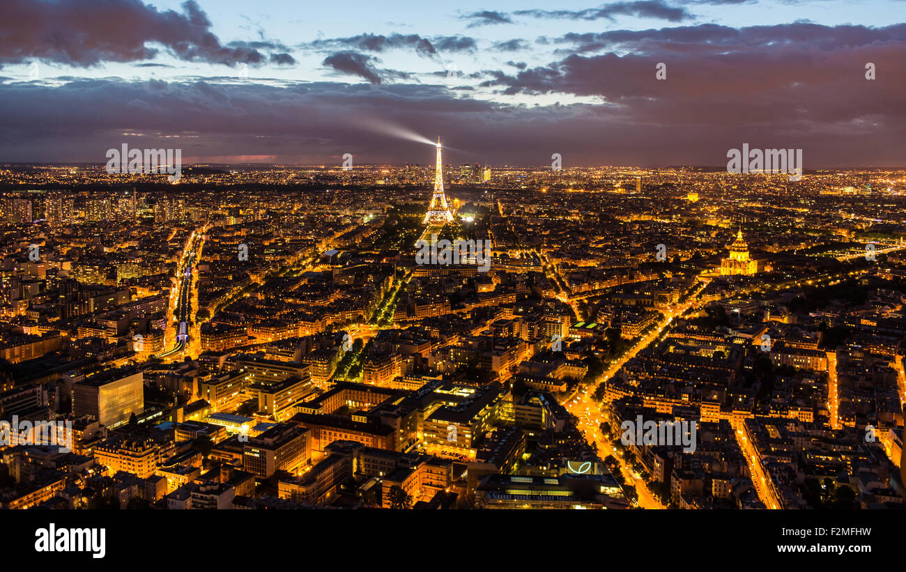 Elevated view of the Eiffel Tower, city skyline and La Defence skyscrapper district in the distance, Paris, France, - Stock Image
