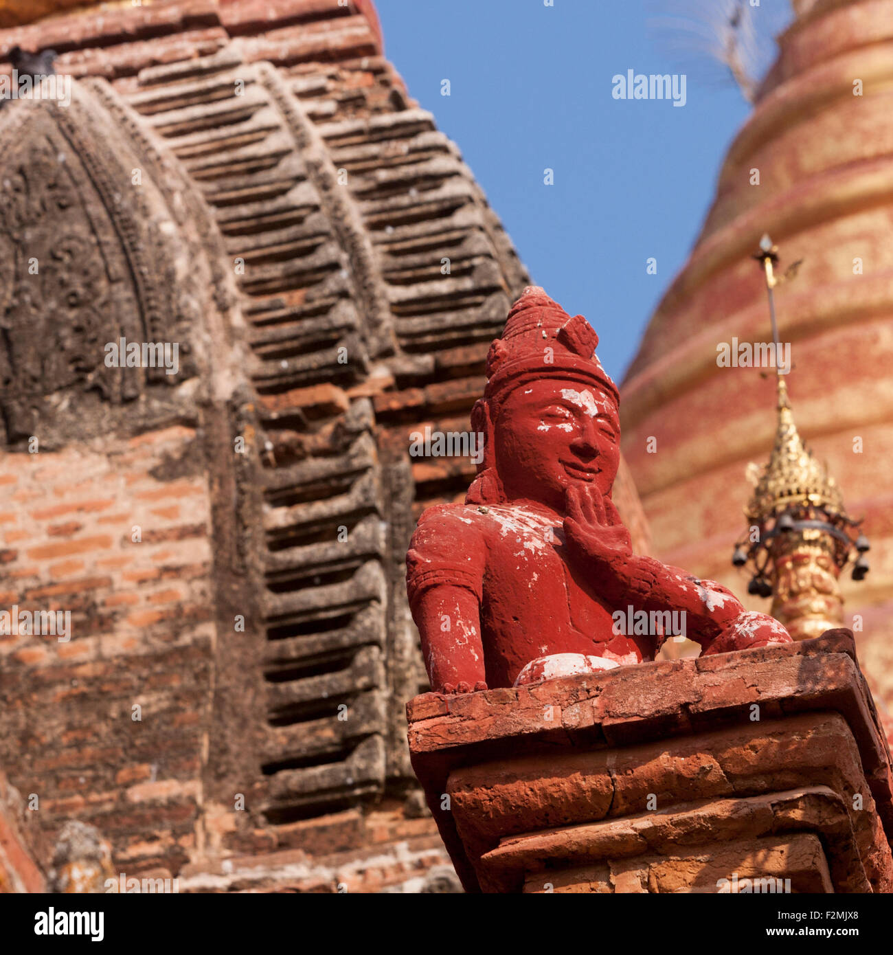 Guardian spirit statue perched on plinth at Dhamma Ya Za Ka 12th century pagoda in Bagan, Myanmar Two stupas in - Stock Image