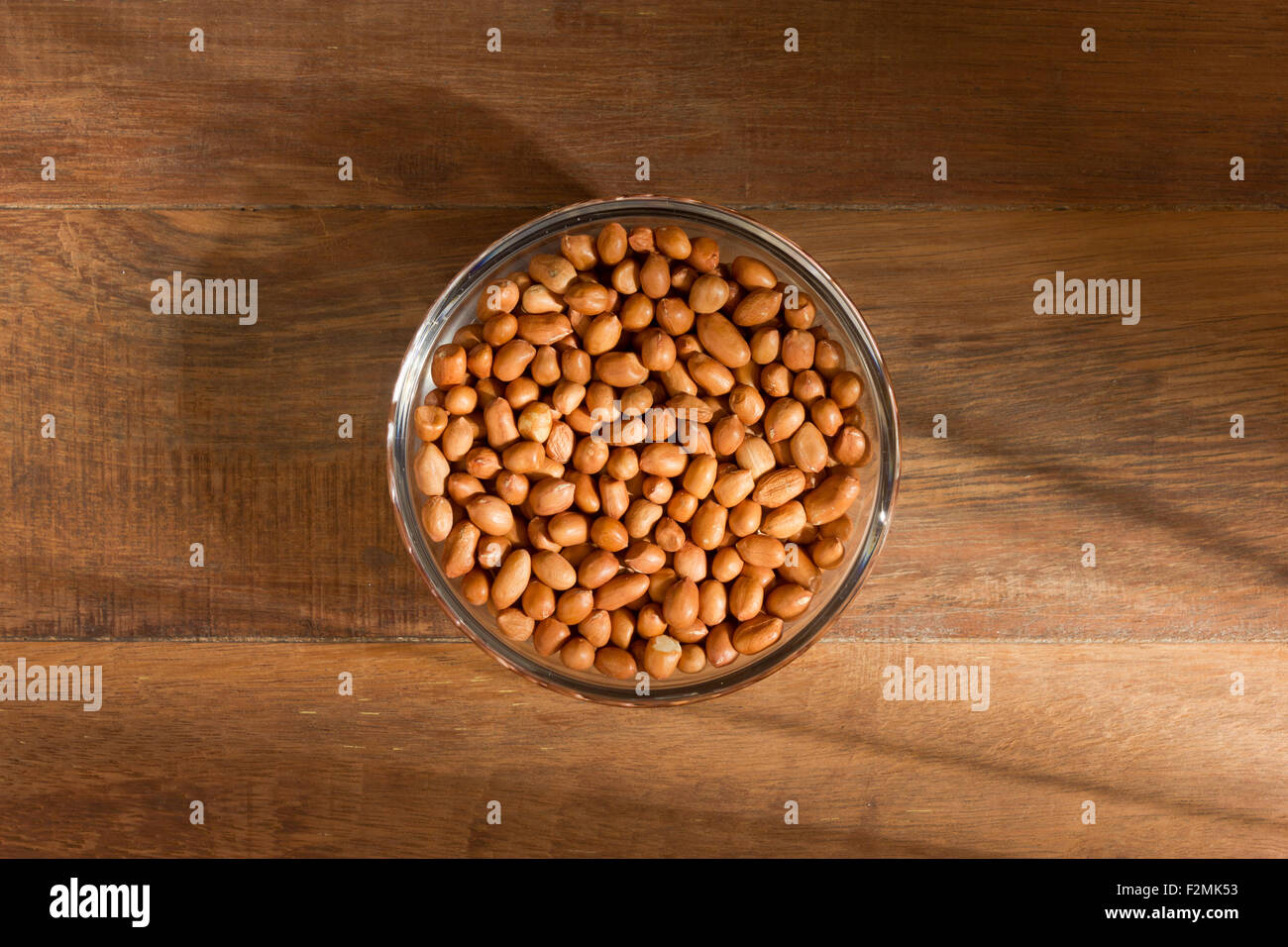 peanuts in a bowl on wood background Stock Photo