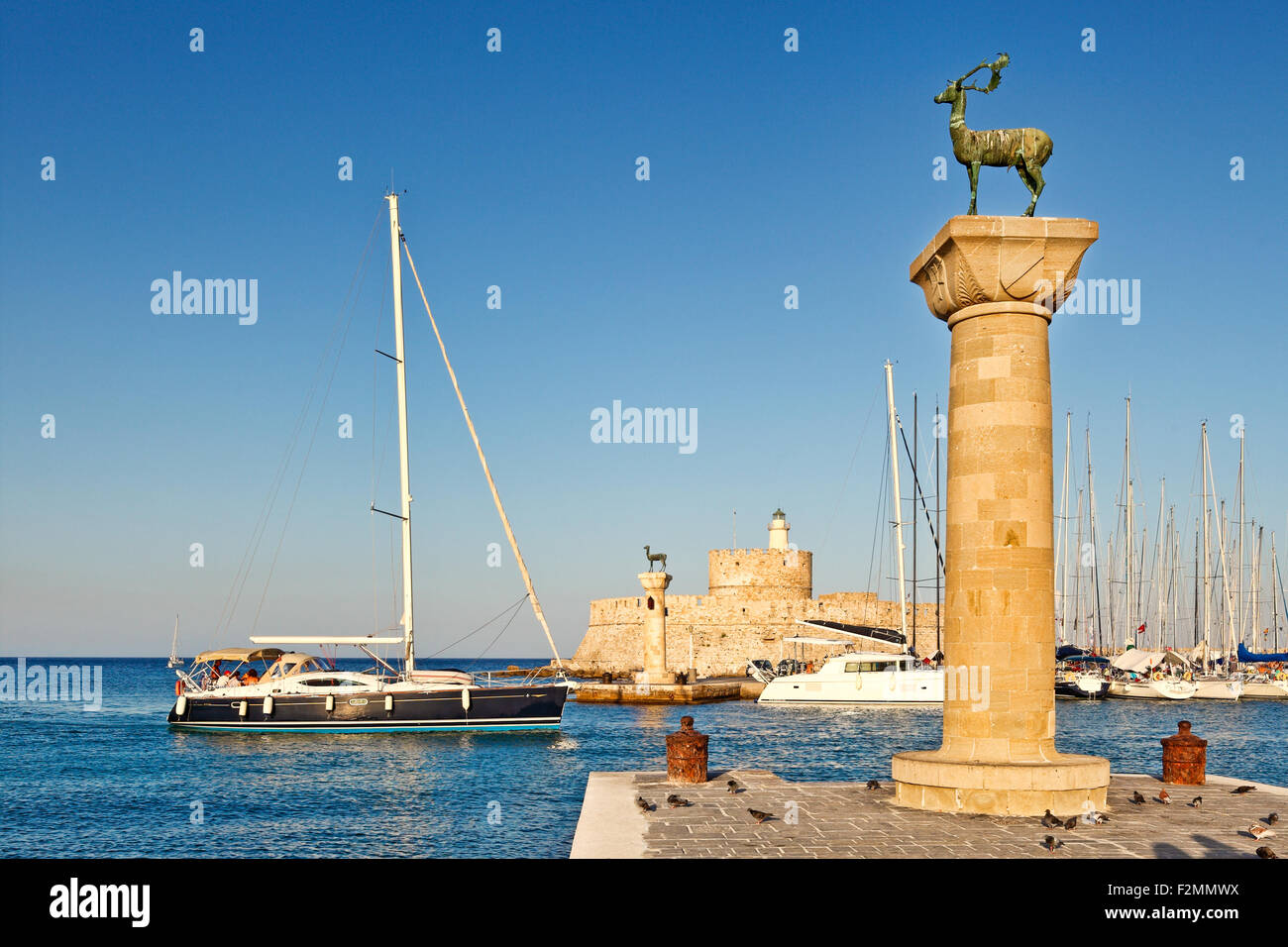 The entrance with the deers of the old port of Rhodes, Greece - Stock Image