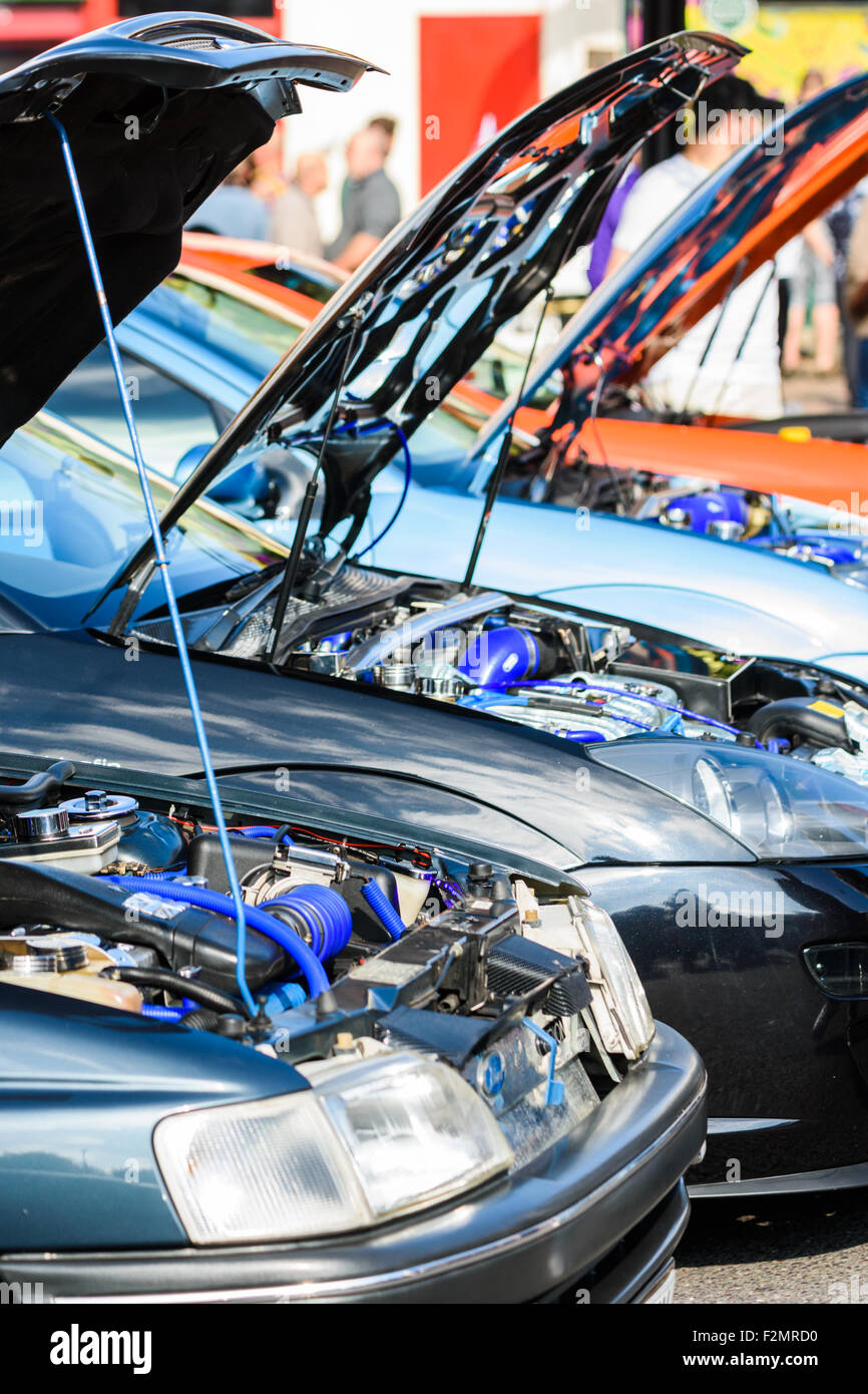 Row of raised bonnets showing modified car engines at the Classic Car Show in Hinckley Stock Photo