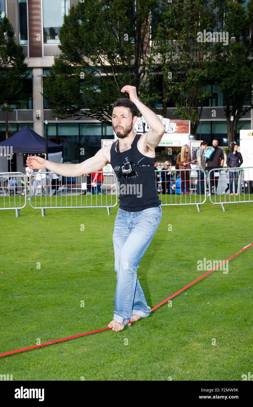 BELFAST, NORTHERN IRELAND - 18 September 2015: Man performing on slackline at Belfast Culture Night - Stock Image