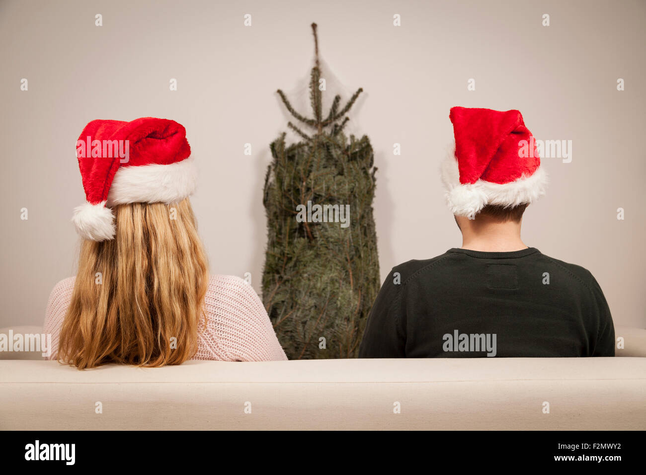 couple with caps on christmas eve - Stock Image