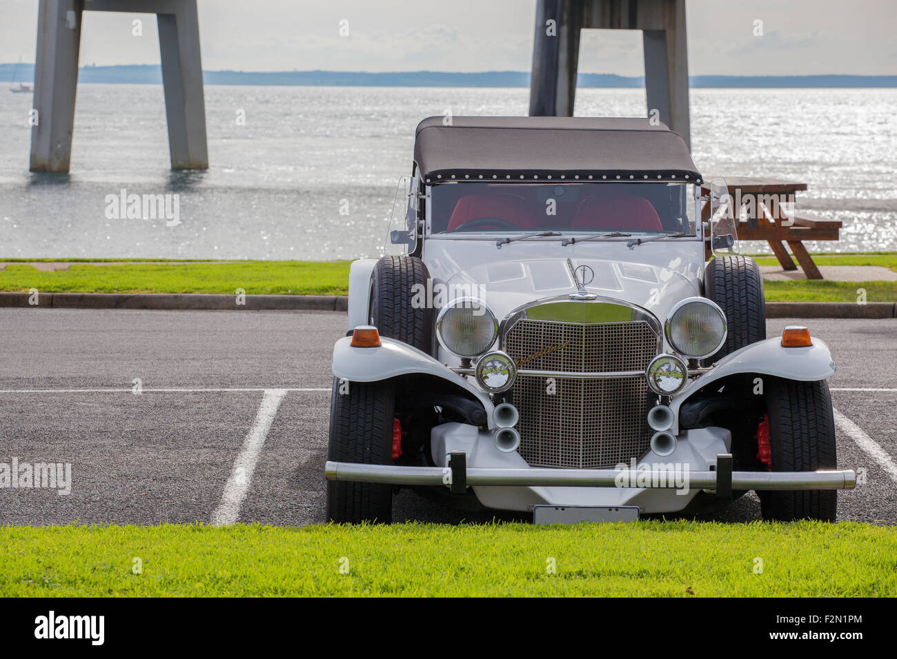 Excalibur vintage car on the beach. - Stock Image