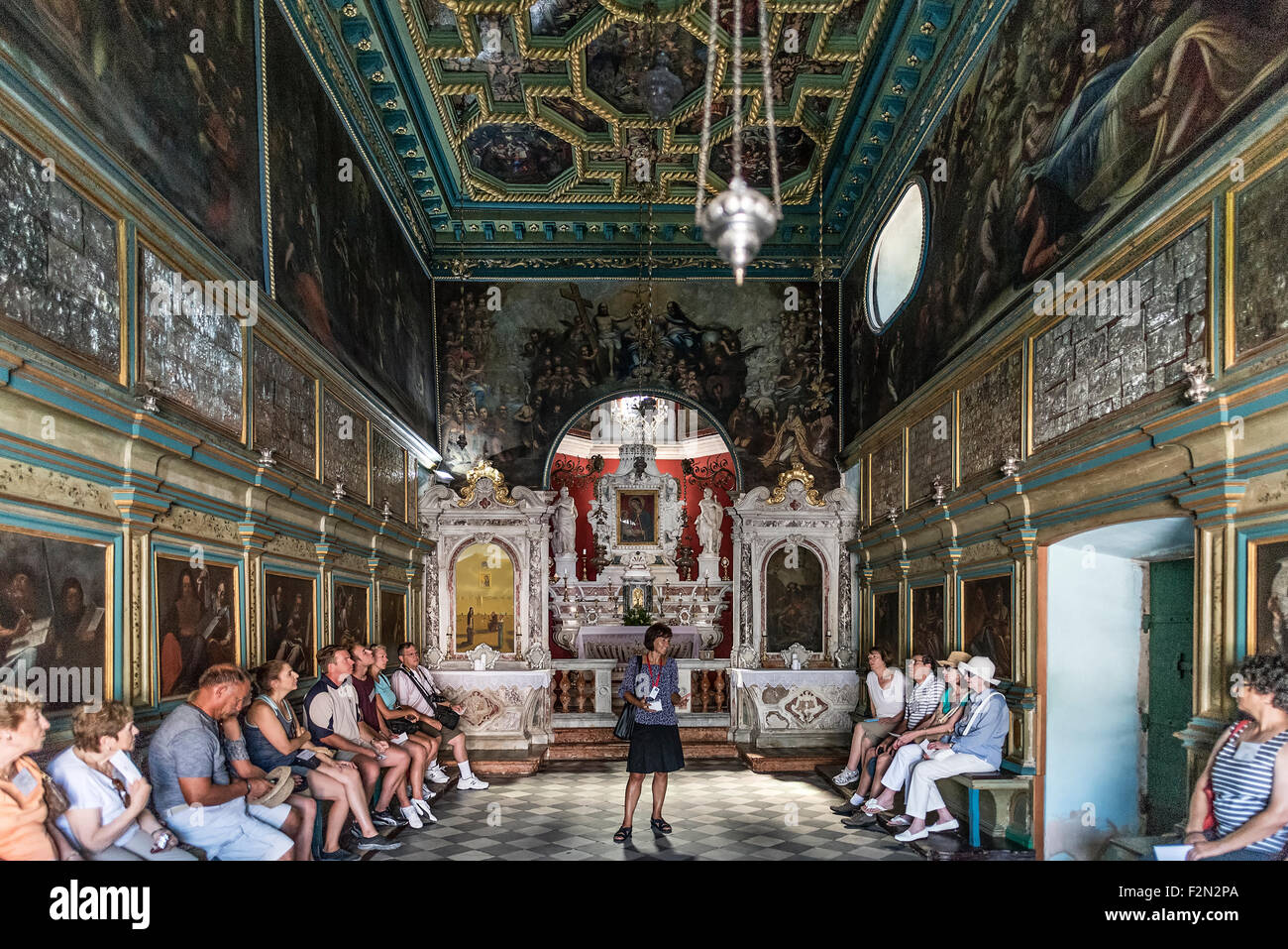 Tour guide explains the history of Our Lady of the Rocks church, Bay of Kotor, Perast, Montenegro - Stock Image