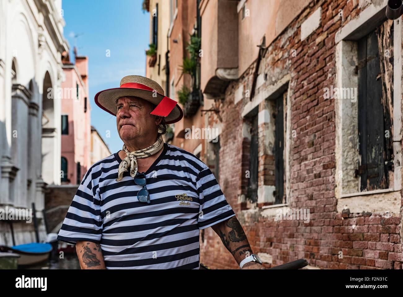 Portrait of a gondolier, Venice, Italy - Stock Image