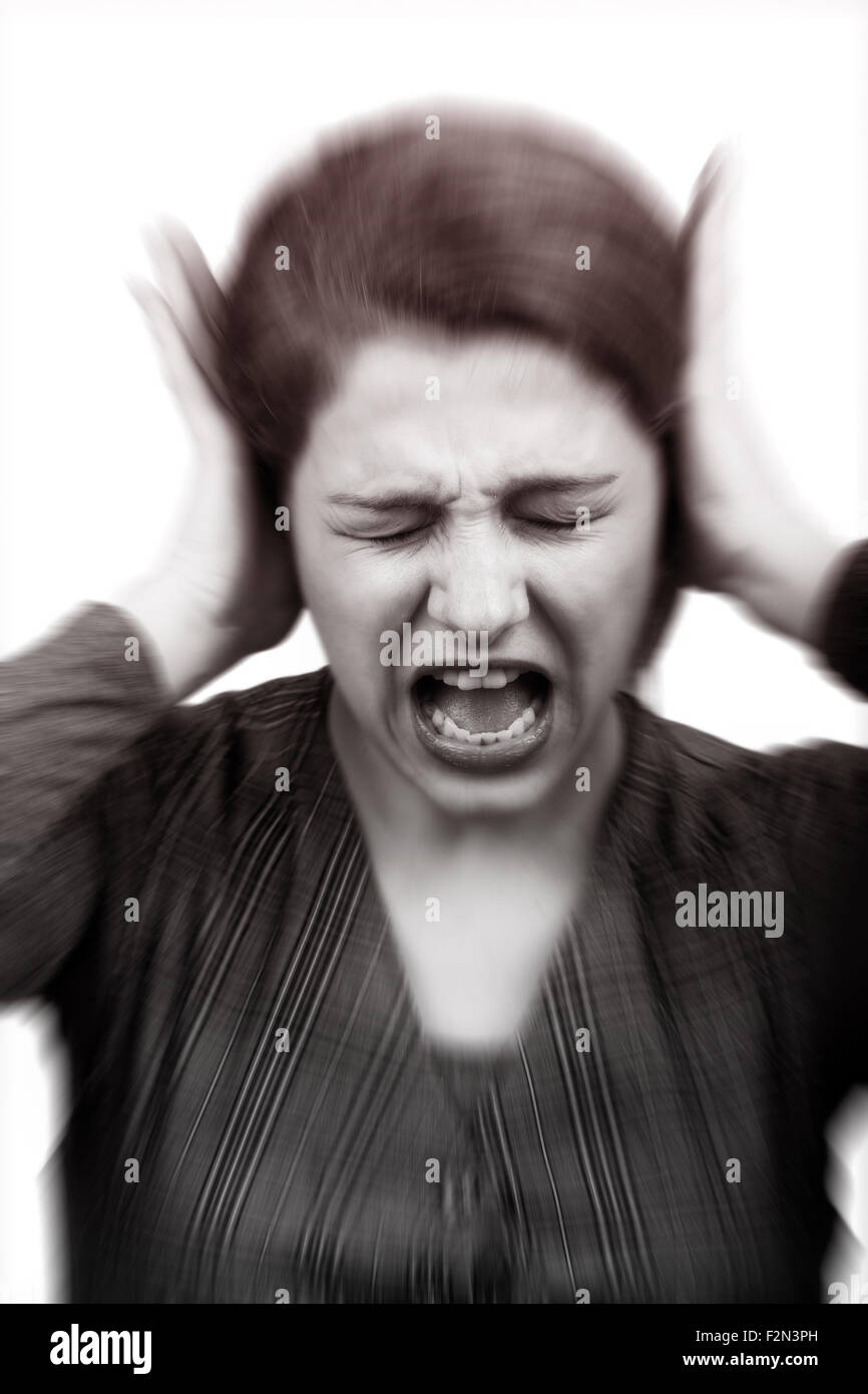 Noise stress concept - stressed woman covering ears - Stock Image