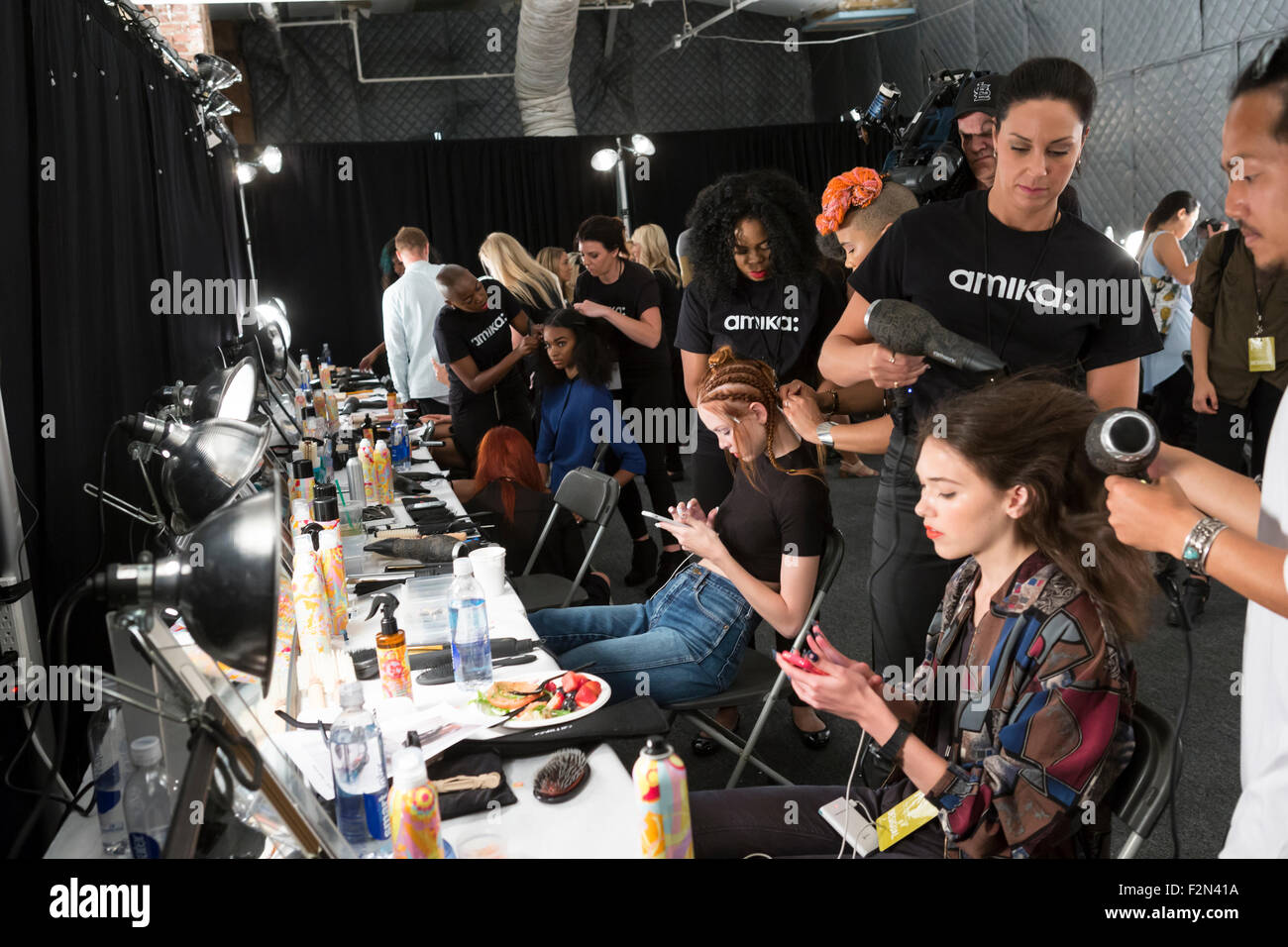 New York, NY - September 10, 2015: Models prepare backstage for the Desigual fashion show - Stock Image
