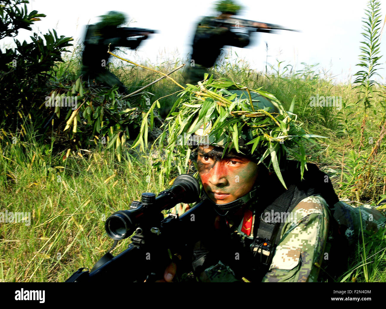 Shanghai, China. 21st Sep, 2015. An armed police sniper lurks during a drill in Shanghai, east China, Sept. 21, - Stock Image