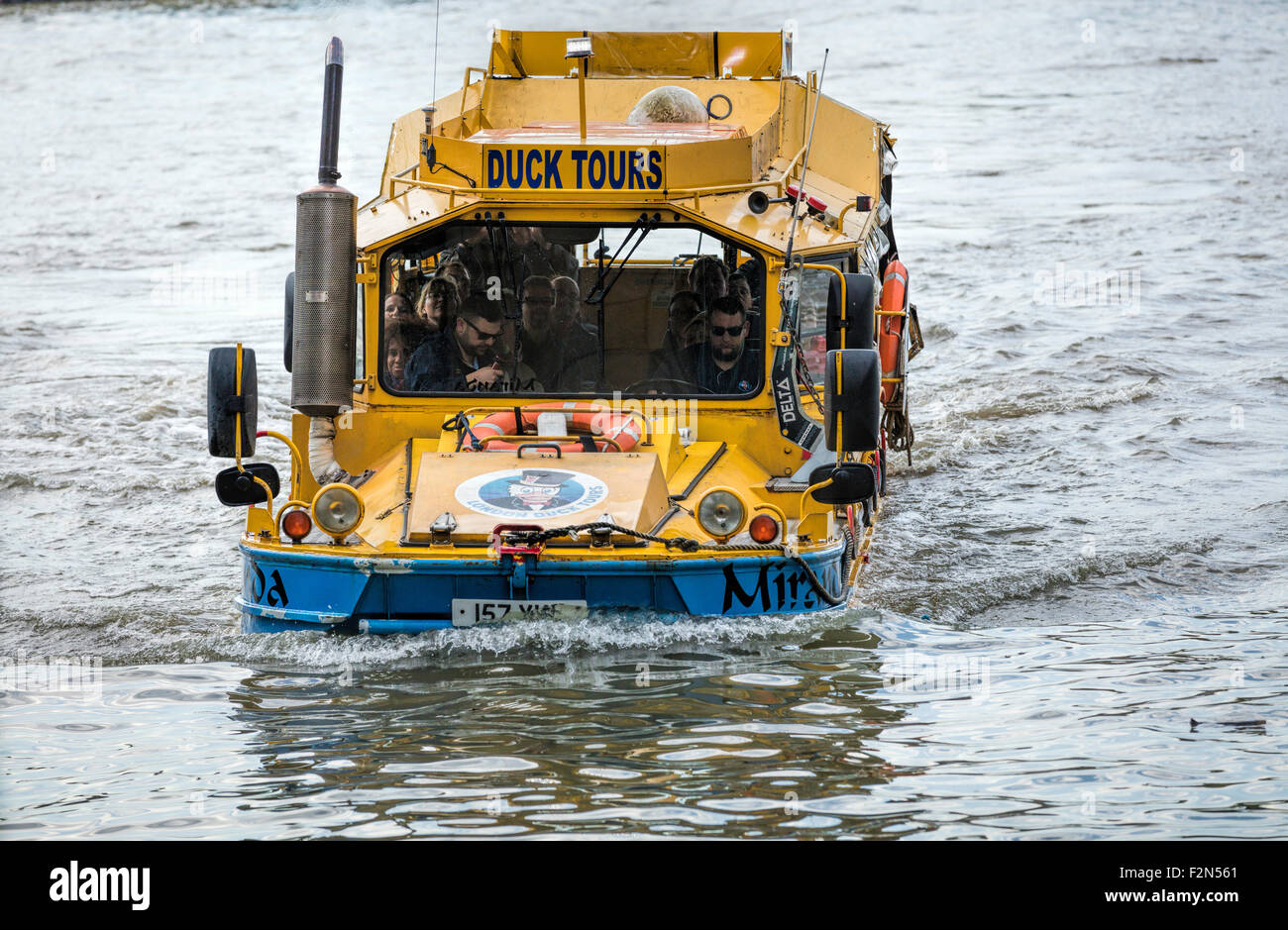Duck Tours amphibious boat leaves the water of the River Thames in London near Vauxhall Bridge. - Stock Image