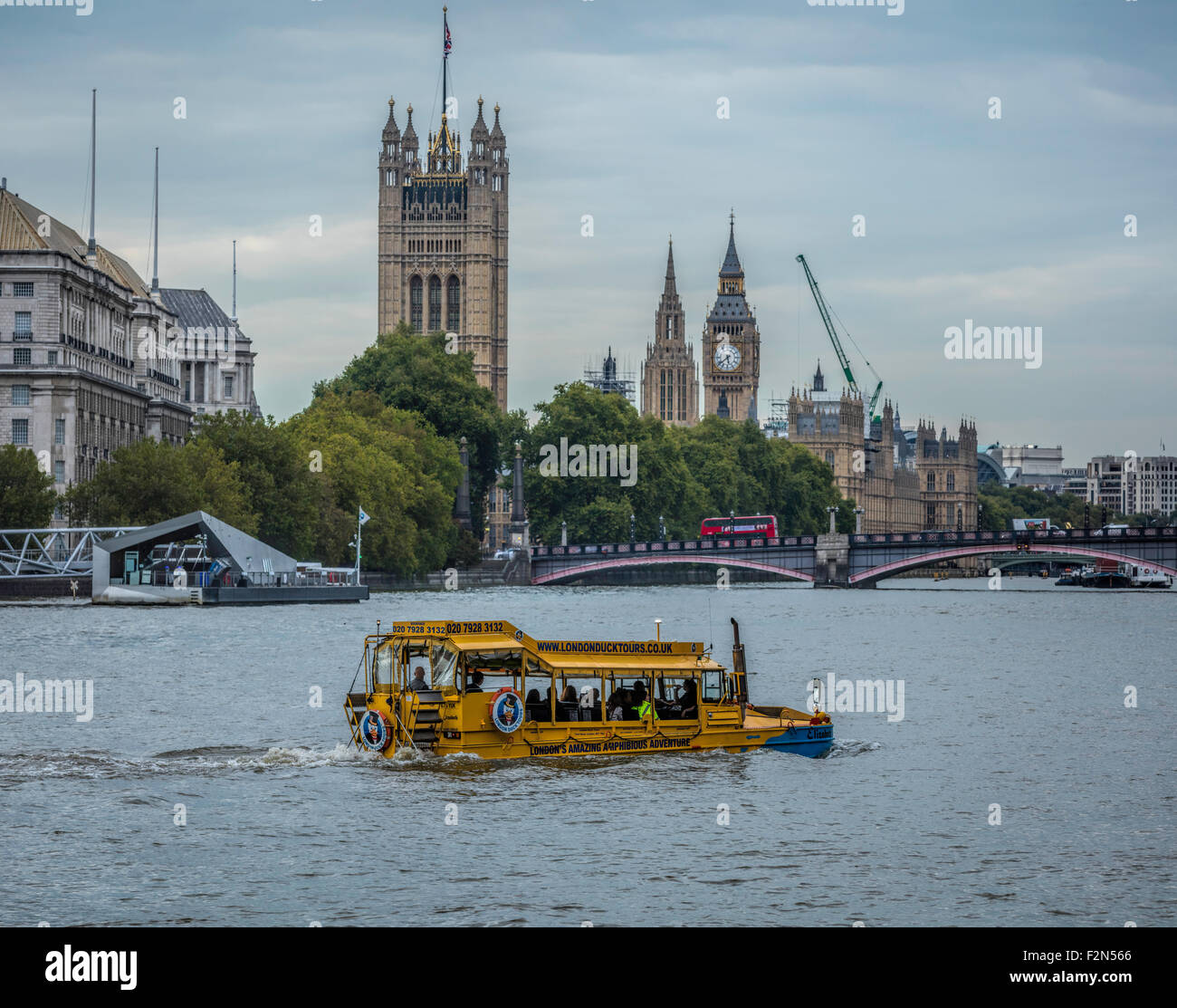 Duck tours amphibious vehicle on the River Thames heading towards Lambeth Bridge and Westminster in London - Stock Image