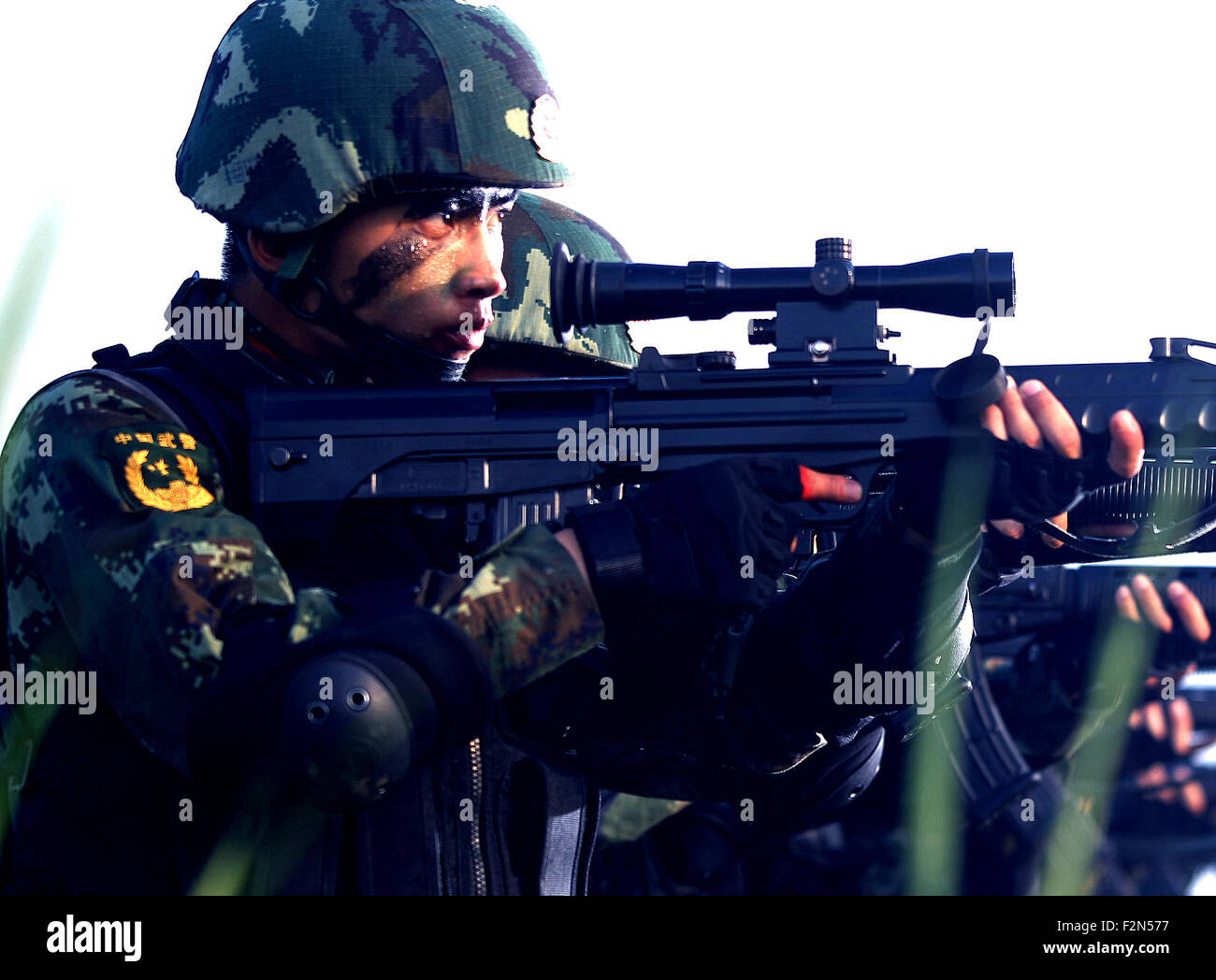 Shanghai, China. 21st Sep, 2015. Armed police sniper Li Jiancheng (L) practises aiming during a drill in Shanghai, - Stock Image
