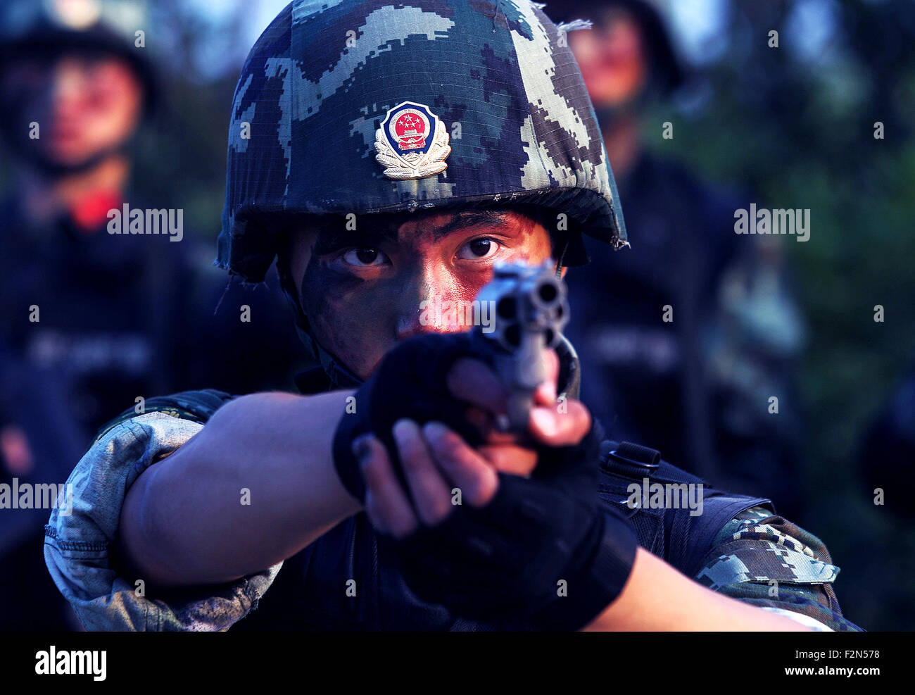 Shanghai, China. 21st Sep, 2015. Armed police sniper He Cheng practises rapid fire during a drill in Shanghai, east - Stock Image