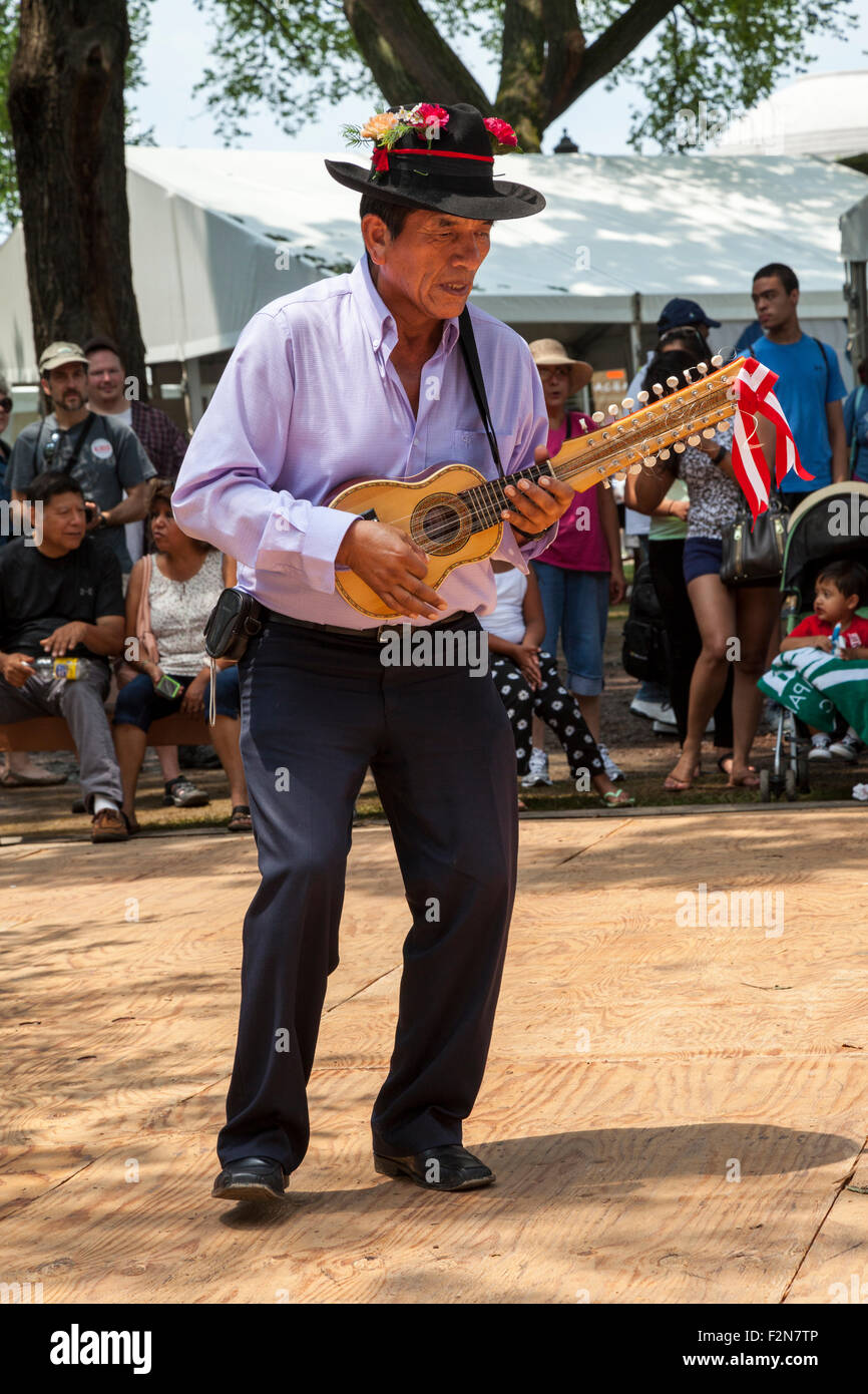 Musician Playing the Charango, a 20-string Instrument, in the Sarawja Dance, a Traditional Aymara Dance from Moquegua, - Stock Image