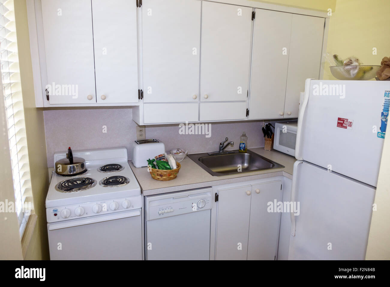 Florida FL South Delray Beach Wright by the Sea hotel Old palm trees guest room kitchen kitchenette stove sink refrigerator - Stock Image