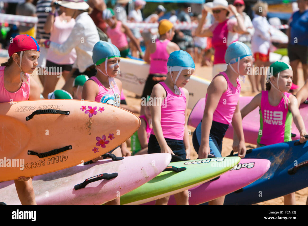 Youngsters from all of Sydney's northern beaches surf life saving clubs compete in surf racing, running and - Stock Image