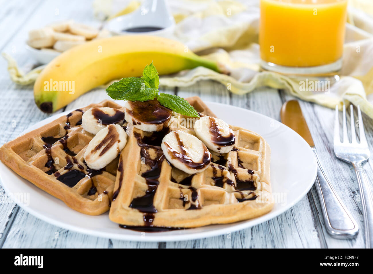 Sweet Breakfast (Waffles with Bananas and creamy Chocolate Sauce) - Stock Image