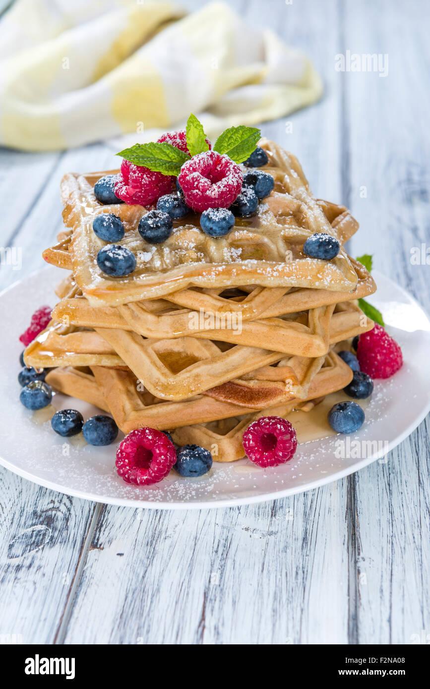 Homemade Waffles with mixed Berries and powder sugar (close-up shot) - Stock Image