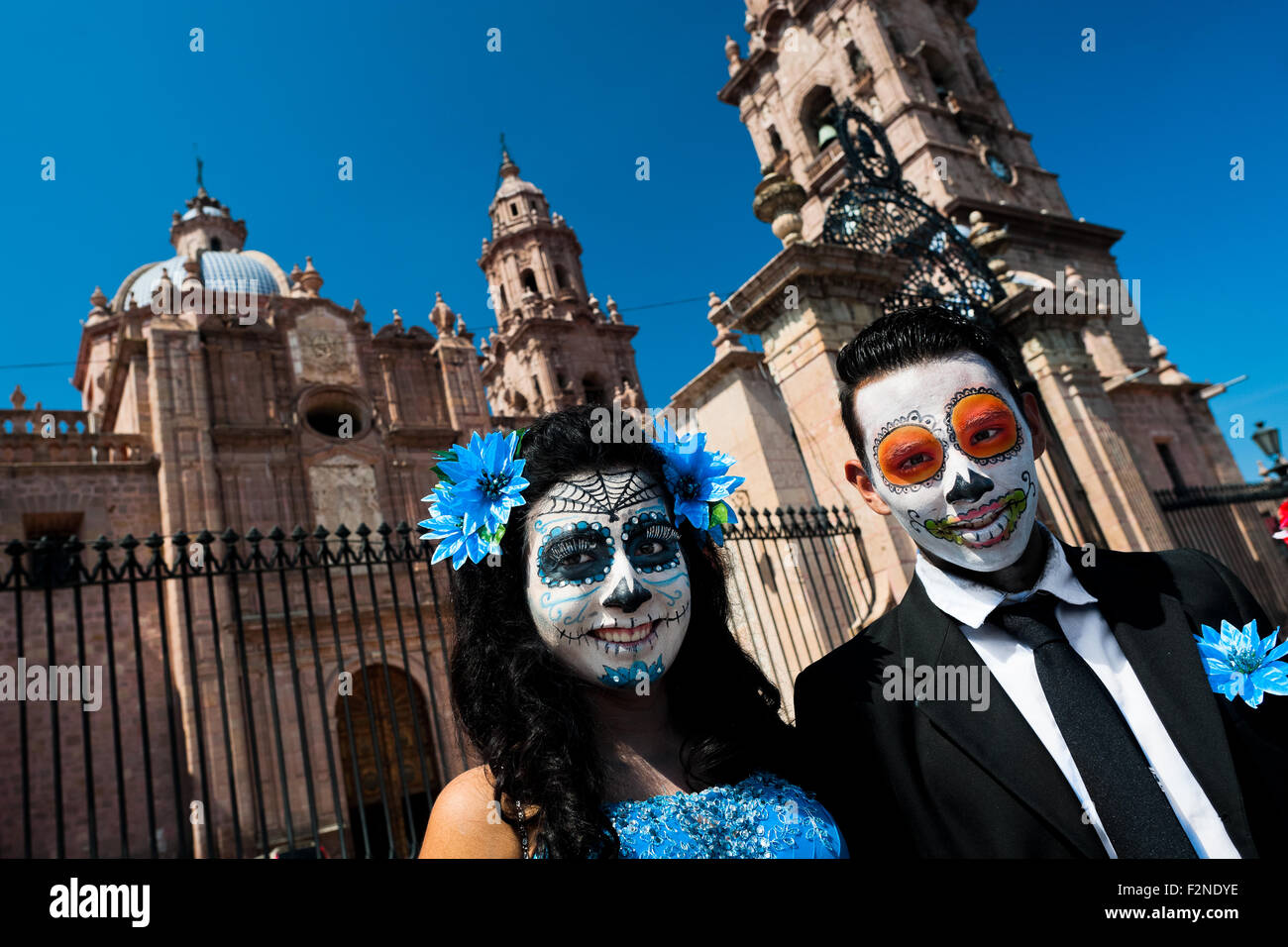 A young couple, costumed as 'La Catrina', poses for a picture during the Day of the Dead festivities in Morelia, Stock Photo