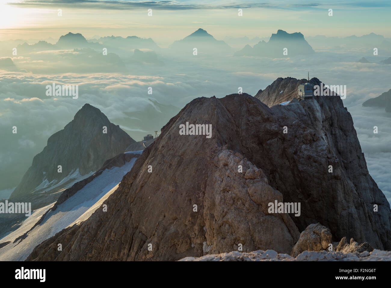 Punta Rocca with cableway station, 3265 m, view from the peak Punta Penia, at sunrise, Marmolada, Dolomites, Alps, - Stock Image